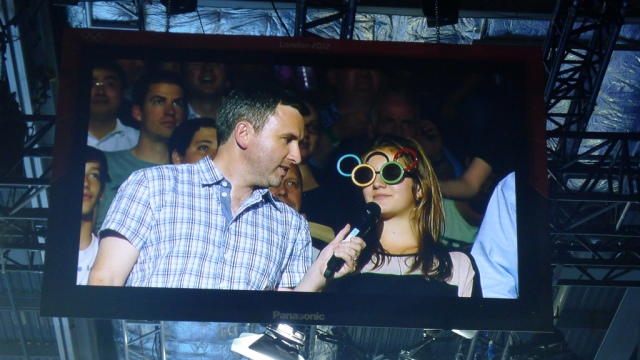 Man interviewing fan in comedy glasses