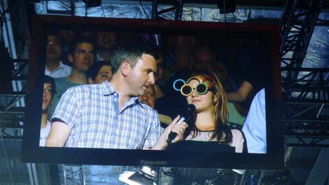 Man interviewing fan in comedy glasses