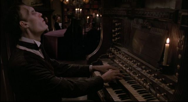 Lurch playing the harpsichord